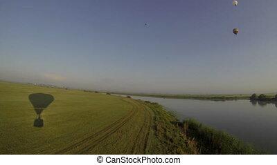 Summer landscape. Shadow of air balloon on field