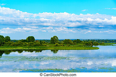 Summer landscape with cloudy sky.