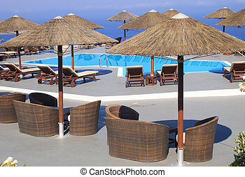 summer landscape with Mediterranean sea, pool and terrace in luxury resort (Greece)