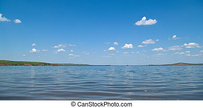 Summer landscape with quiet water of lake