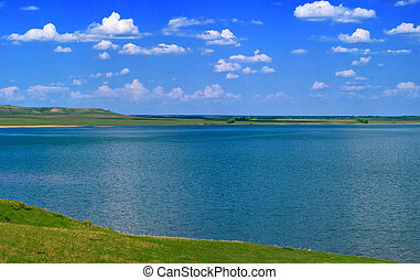water of lake and cloudy sky