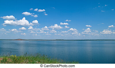 quiet water of lake and cloudy sky