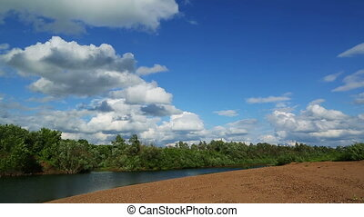 summer landscape with river and clouds - timelapse