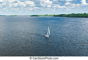 Summer landscape with sailboat on Dnipro river