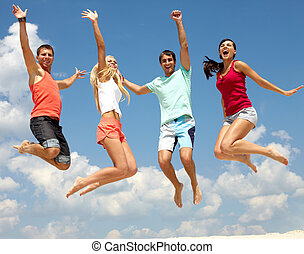 Summer leap - Portrait of four jumping happy people