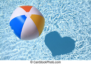 Summer love, Beach Ball on the swimming Pool with heart...