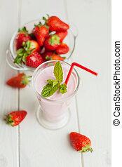 Summer milk shake on white wood