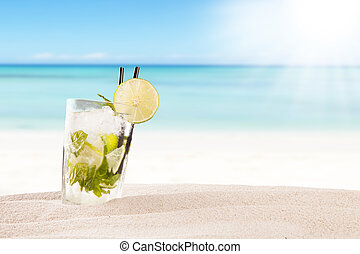 Summer mojito drink with blur beach on background