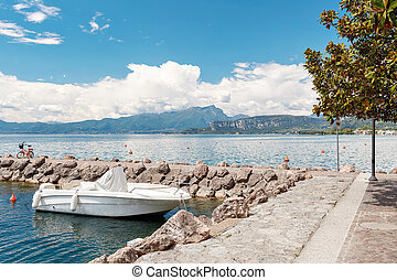 Summer morning on Lake Garda. Italy, Europe. It is located in Northern Italy, about half-way between Brescia and Verona, and between Venice and Milan.