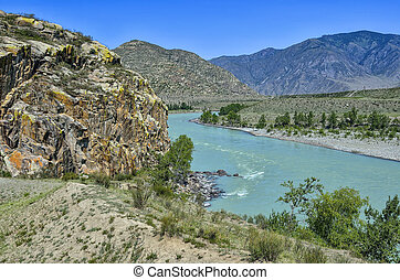 Summer mountain landscape with turquoise river and colorful rocks