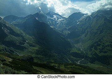 Summer mountain peaks of the Alps mountains covered with snow