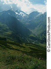 Summer mountain peaks of the Alps mountains covered with snow.