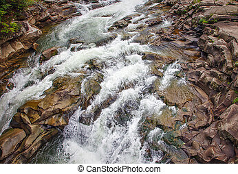 Summer mountain river waterfalls