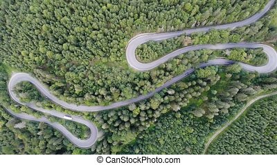 Summer mountain road winding, traffic drone view. Mountain...