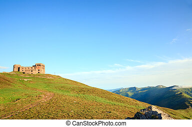 Summer mountain view with observatory ruins on mountain top