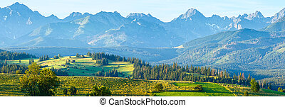 Summer mountain village outskirts and Tatra range behind (Gliczarow Gorny, Poland)