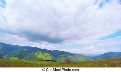 Summer Mountains Landscape with Haystack and Clouds.