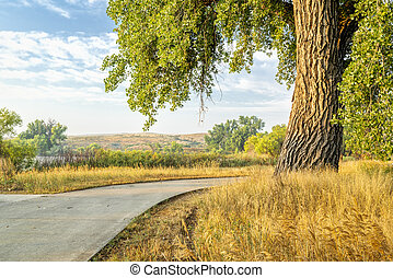 summer on the Poudre River Trail in northern Colorado near Windsor. It is a paved bike trail extending more than 20 miles between Timnath and Greeley.