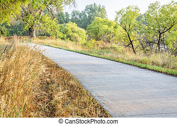 summer on the Poudre River Trail in northern Colorado near Windsor. It is a paved multi-use trail extending more than 20 miles between Timnath and Greeley.
