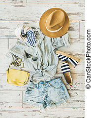 Pastel summer women's clothes, parquet background, top view