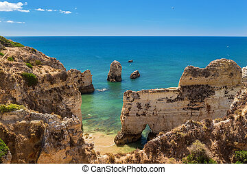 Summer panorama of sea landscape. The cliffs in Albufeira, Portugal.