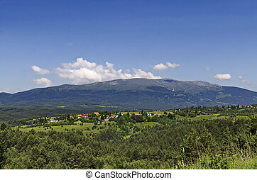 Summer panoramic view of the neighborhoods of the village of Plana
