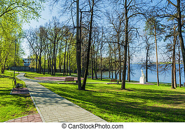 Summer Park on the shore of the pond