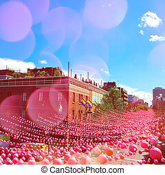 Summer party street in gay neighborhood decorated with pink balls