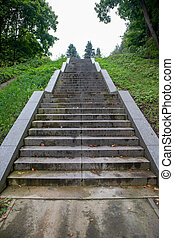 Photo of a long granite staircase in the park