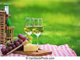 Summer picnic - Various sorts of cheese, grapes and two ...