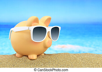 Summer piggy bank with sunglasses on beach
