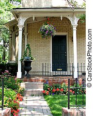 Summer Porch 01 - A walkway leads up a few small stairs to a...