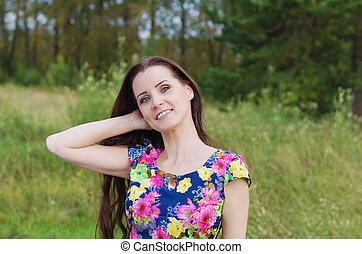 Summer portrait of a beautiful woman