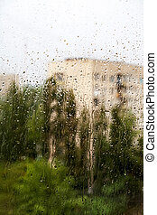 Summer rain in the city blurry background