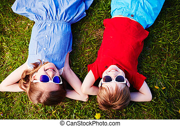 Summer relax - Carefree children in sunglasses relaxing in...