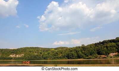 summer river landscape with boat