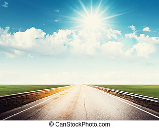 Summer road, sky, sun and clouds background