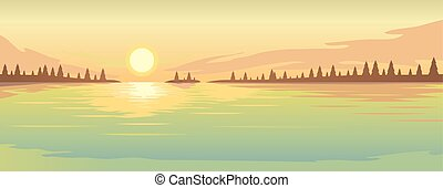 Sunset over the lake and fir forest on the coast.