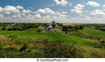 Summer rural landscape with orthodox temple in Russia -...