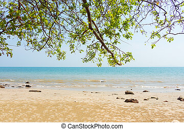 Summer sandy beach with blue sea background.