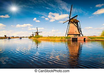 Summer scene in the famous Kinderdijk canal with windmills. ...