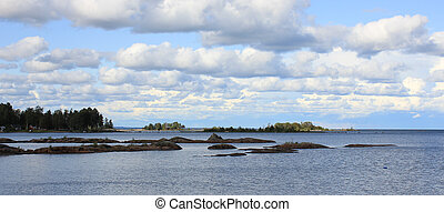 Summer scene in Vita Sannar. Rock formations at the shore of...