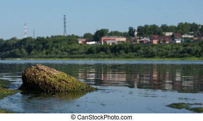 Summer scenic view of small town near river