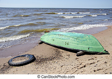 summer sea beach with green boat