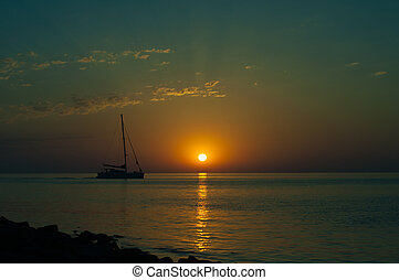 Summer sea sunset with sailboat