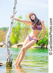 summer shooting glamorous girl on the lake
