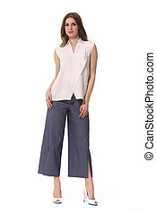 summer short sleeve shirt blouse high heels and culottes trousers on brunette indian woman