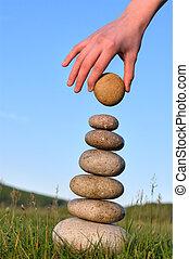 equilibrium - Summer. Someone's hand constructs equilibrium...