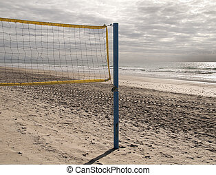summer sport - a net to play beach volleyball