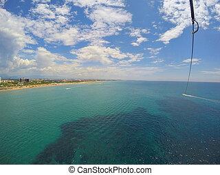 Summer sport in summer resort, parasailing view in...
